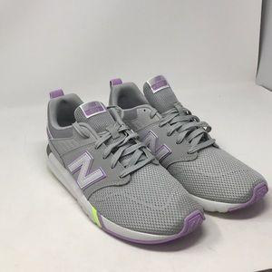 New Balance Women's 009 V1 Sneaker,